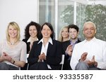 Business team applauding after a conference in a company - stock photo