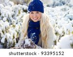 beautiful winter woman with snow - stock photo
