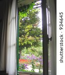 view through window out onto garden - stock photo