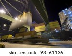 Cargo ship loading containers by night - stock photo