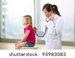 Female doctor examining child with stethoscope. - stock photo