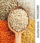 Lentils, Beans, Peas, Soybeans, Legumes with Wooden Spoon - stock photo