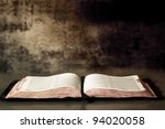Open Bible, with textured granite background. - stock photo