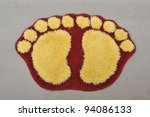 Door Mat With Footprints Design - stock photo