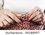 Hands of a young woman knitting - stock photo