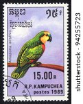 Small photo of KAMPUCHEA - CIRCA 1989: A stamp printed in KAMPUCHEA shows a Amazon (Amazona aestiva), from series Breeds of parrots, circa 1989