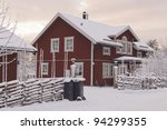 Swedish rural red house in a winter mornings setting - stock photo