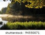 Calm Lake In  Sunrise