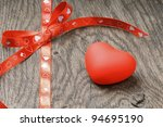 red heart on wooden background | Shutterstock . vector #94695190