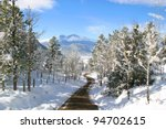 Windy Snow Covered Mountain Road