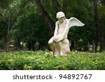 Statue Of Sitting Angel In The...