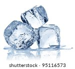 Three Ice Cubes On White...