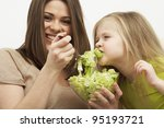 mother feeds little girl with... | Shutterstock . vector #95193721