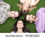young people lying down on grass | Shutterstock . vector #95383282