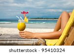 woman holding a fruit cocktail... | Shutterstock . vector #95410324