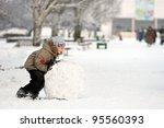 Joyful Boy Sculpts A Snowman I...