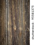 Section of an old door with wooden planks with knots - stock photo