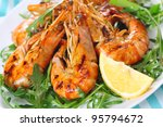 fresh grilled shrimps with Lemon close up - stock photo