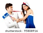Joyful young couple enjoy roleplay in sailor uniform and elegant suit. Isolated on white background. High resolution studio image - stock photo