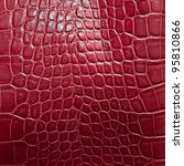 crocodile skin texture in red color - stock photo