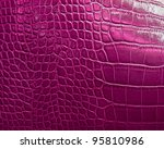 crocodile skin texture in pink color - stock photo