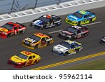 DAYTONA BEACH, FL - FEB. 23: The NASCAR Sprint Cup teams take to the track for the Gatorade Duel 1race at the Daytona International Speedway in Daytona Beach, FL on Feb 23, 2012. - stock photo