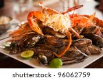 Dish with crab and mussels. Selective focus on the crab's body. - stock photo