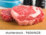 Raw ribeye steak - stock photo