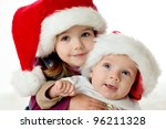 brother and sister with  santa hats - stock photo