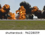 Multiple large explosions on airport runway - stock photo