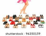 A picture of sexy female legs among shoes over white background - stock photo