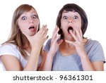 two young women with a shocked expression - stock photo