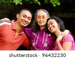family portrait of asian ethnic senior woman with young adult son and daughter - stock photo
