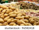 Big potatoes in supermarket stand - stock photo
