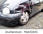A black wrecked car - stock photo