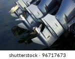 Three Outboard Boat Motors