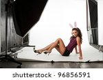 Young and sexy bunny model posing in professionally equipped studio - stock photo