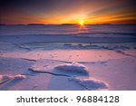 Sunrise over frozen and snowy coastline of Finland - stock photo