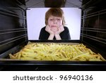 boy at the oven baking french fries - stock photo
