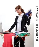 young businesswoman works on laptop while ironing - stock photo