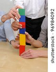 Business teamwork concept: Building tower of blocks - stock photo