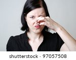 woman is disgusted by the stench - stock photo