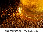 Pale malt, crystal malt, chocolate malt and beer - stock photo