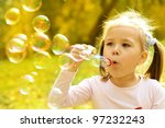 Cute Little Girl Is Blowing A...