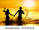 Silhouette Of Sea Bathing Of...