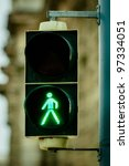 Green pedestrian lamp in the city - stock photo