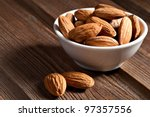 almonds isolated on the white... | Shutterstock . vector #97357556