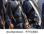 Small photo of US Civil War Confederate re-enactors marching in formation
