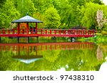 Bridge in japanese garden in spring - stock photo