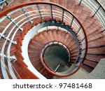 A winding staircase with steps made from wood - stock photo